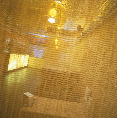 room-68-by-anarchitect-gold-curtain.jpg