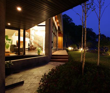 z-house-by-hohyun-park-hyunjoo-kim_view-of-living-area-from-ga.jpg