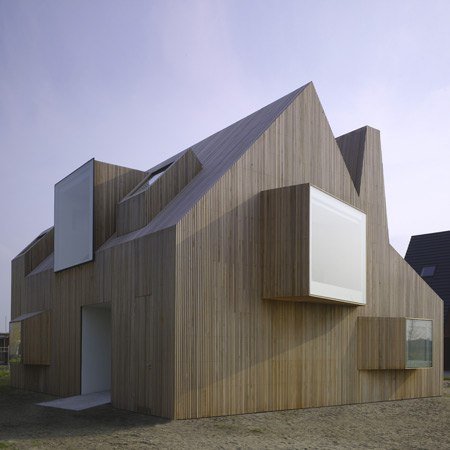 House bierings by rocha tombal dezeen - The house with protruding windows ...