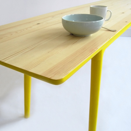 Trend Called E the table is long and narrow so that items used for working at the table can be pushed aside at meal times