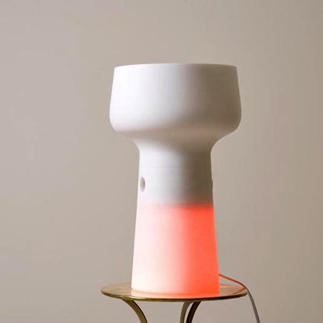 Dezeen: The lamp is yellow with the switch inserted and turns red when removed