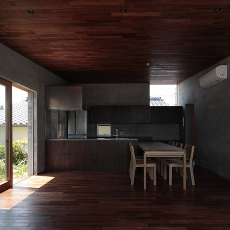 House with a wall by MasaoYahagi Architects