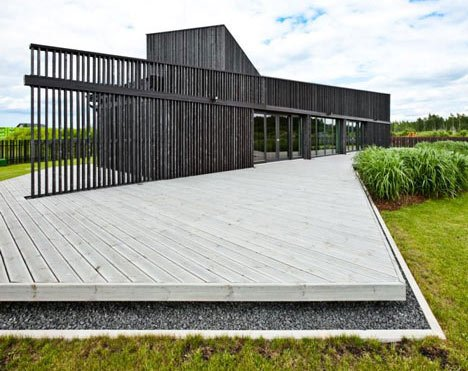House in Marupe by Open AD