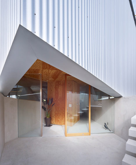 House in saka by suppose design office dezeen for Office entrance design
