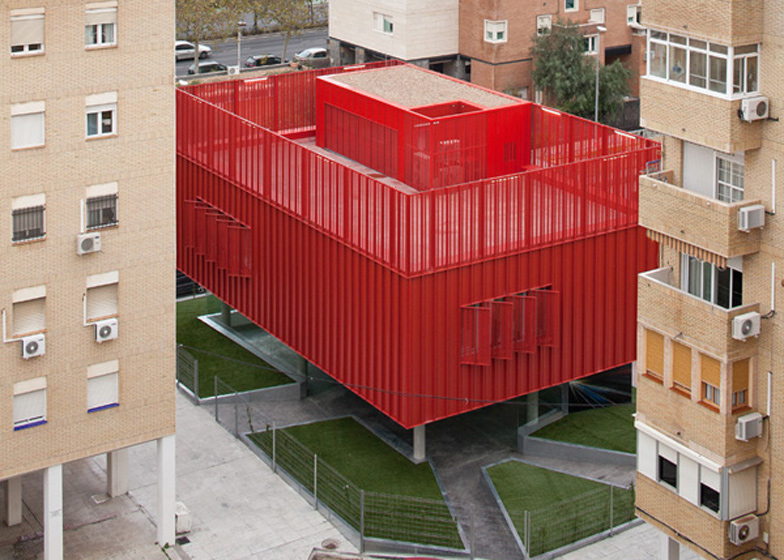 The bright red Cibercentro Macarena multimedia centre is nestled conspicuously between drab apartment blocks in Seville