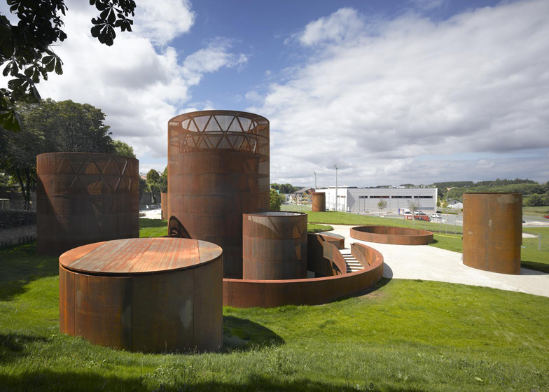 Weathered steel towers and cylinders poke through the grass at this underground museum in the historic city of Lugo