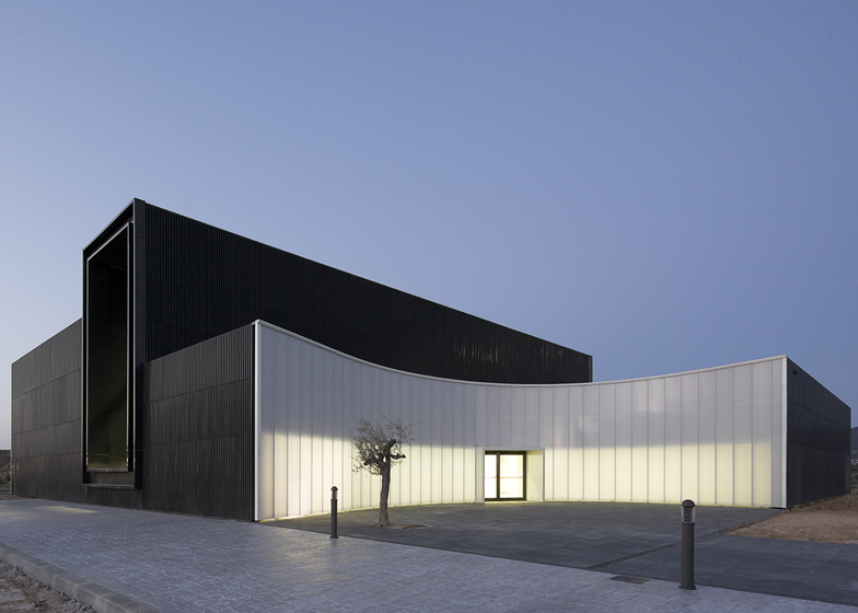 Visitors enter this museum of energy near Tarragona through a translucent curved wall