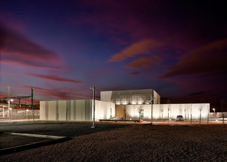 A bumpy steel exterior lets light sparkle through the walls of this railway control centre in Albacete