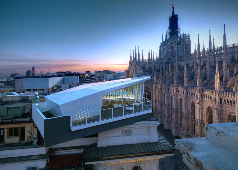 The Cube overlooking the Duomo cathedral in Milan