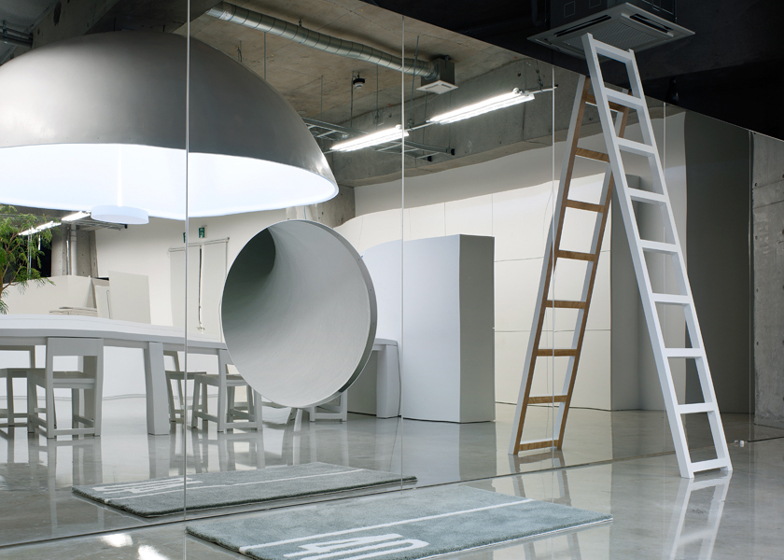 Schemata Architecture Office hid a slide behind a mirrored wall in this office