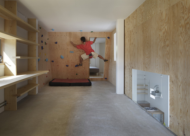 There's a climbing wall inside this house by Tato Architects