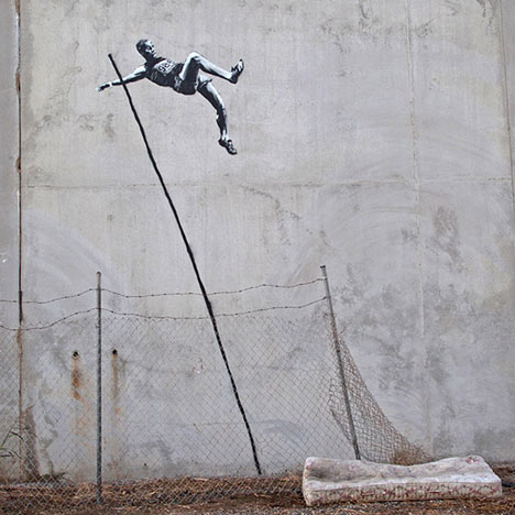 London 2012 street art by Banksy - pole vault with barbed wire and mattress