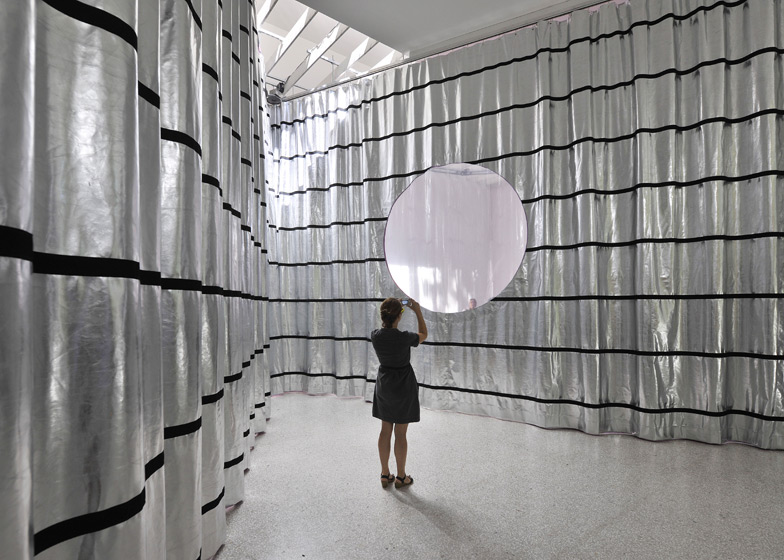 At the Dutch Pavilion huge curtains move around the space to create differently shaped enclosures (photo by Rob 't Hart)