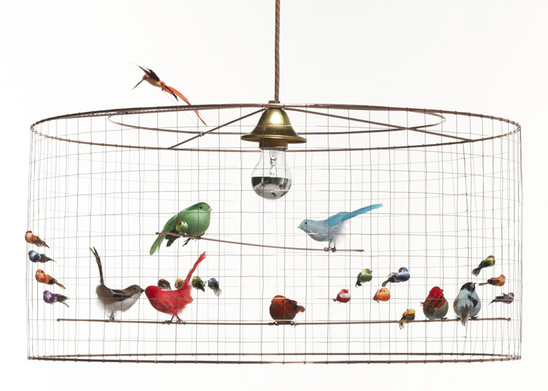 Cage-like lamps filled with ornamental birds are on display at the Challieres stand.