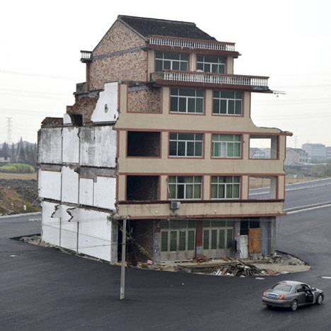 House demolished from centre of a Chinese motorway