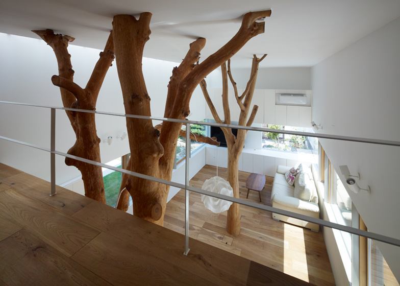 Two trees felled to make way for this house extension in Kagawa were reinstalled in the living room by architect Hironaka Ogawa.