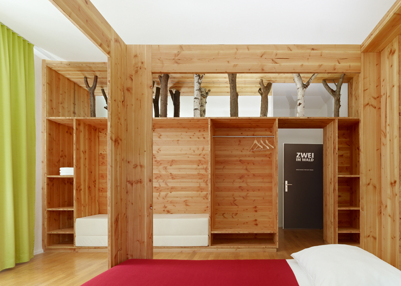 Tree trunks populate the guest rooms of this hotel in Ramsen, Germany, by Naumann Architektur.