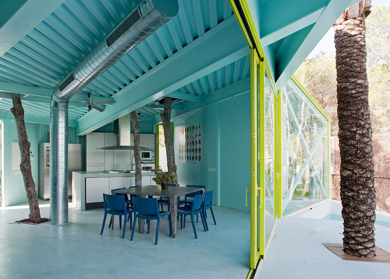 Architect Andrés Jaque let trees and shrubs poke through the cascading terraces of this house on stilts in Ibiza.