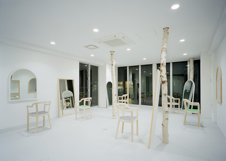Another salon pierced by birch trunks, this time in Tokyo by Isolation Unit.