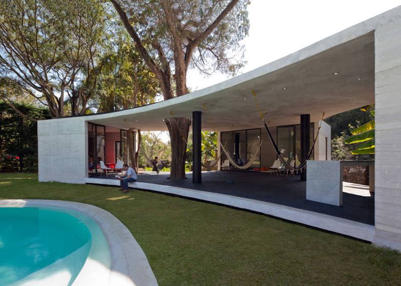 Cadaval & Sola-Morales built this concrete guesthouse in Mexico around two huge trees.