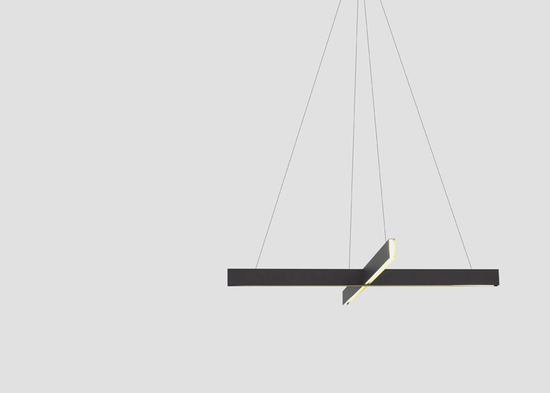Cross pendant lights by Resident Studio comprise two intersecting aluminium channels that emit light through a recessed diffuser.