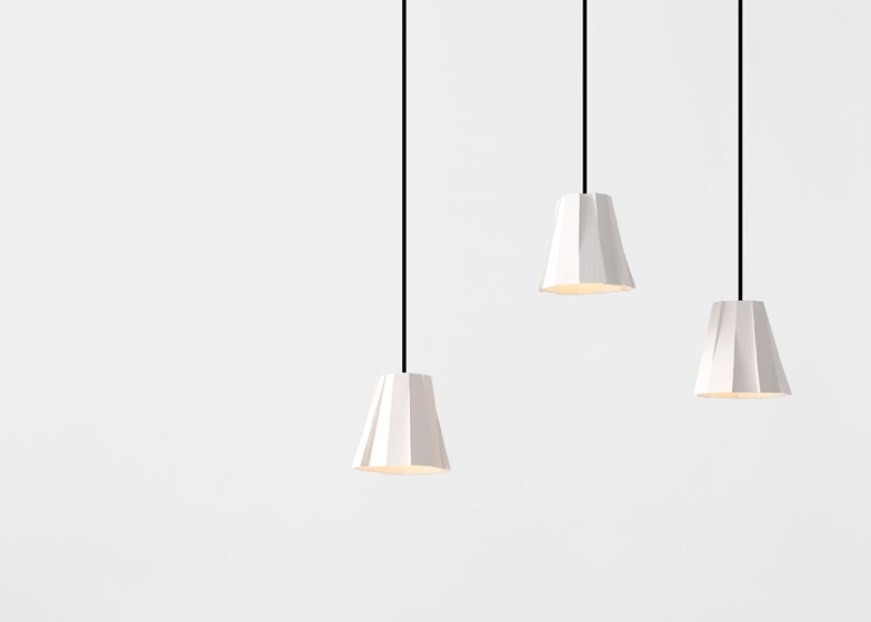 Segment ceramic pendant shades by Phil Cuttance are made up of eleven faces, each cut on a bandsaw at different angles to reveal horizontal textures.