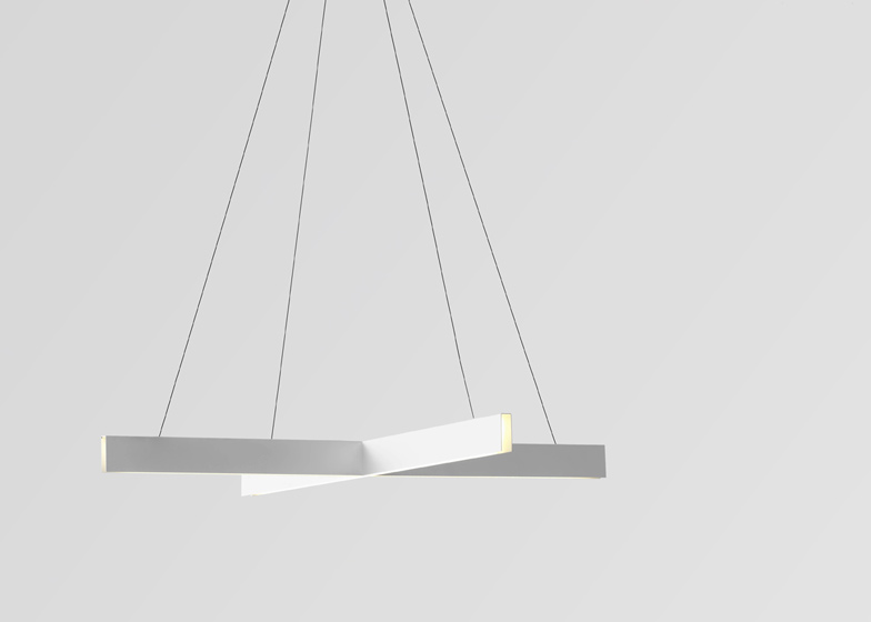 Cross pendant lights by Resident Studio  are available in black and white.