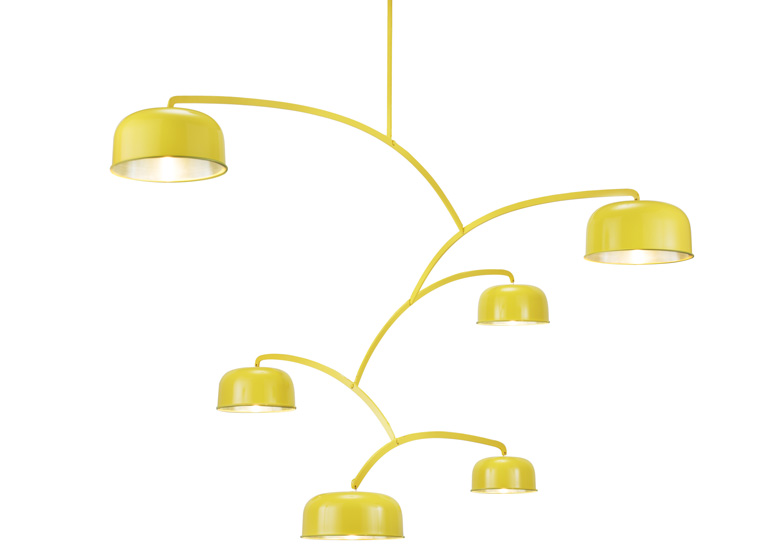 Mobile lamp comprises a series of shades carefully balanced against each other on armatures.