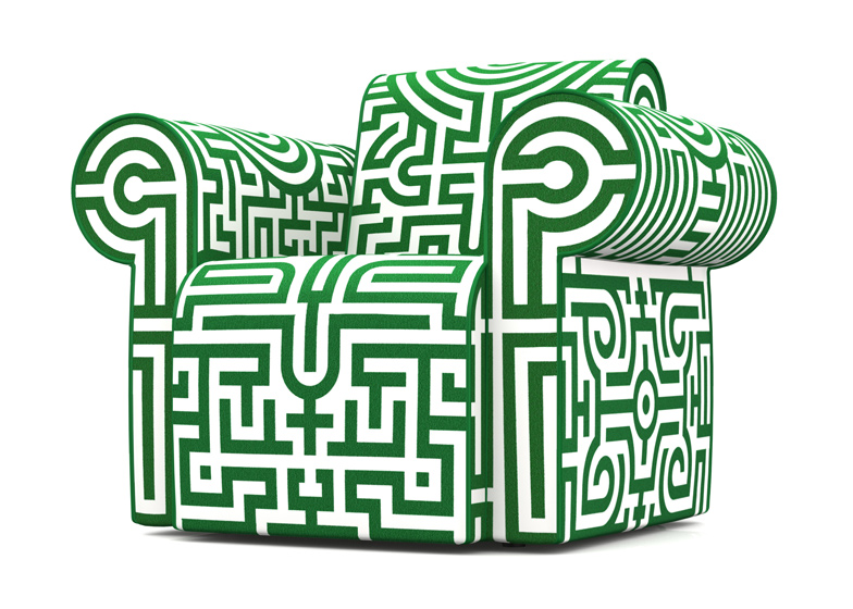 Labyrinth chair original by Studio Job is covered with a maze of geometric patterns.