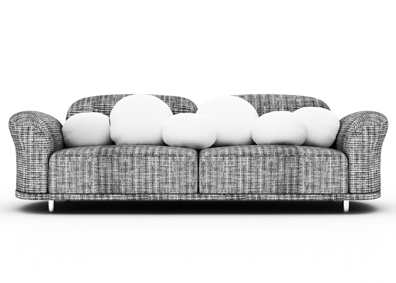 Cloud sofa by Marcel Wanders is wrapped in textured fabric and scattered with plump white cushions.