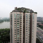 Man ordered to remove fake mountain villa on top of Chinese tower