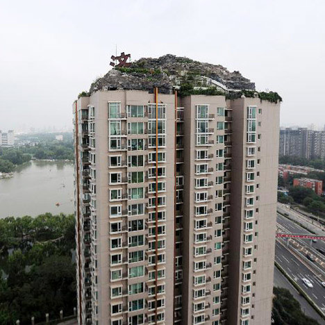 dezeen_Mountain-built-on-top-of-Chinese-apartment-block_1