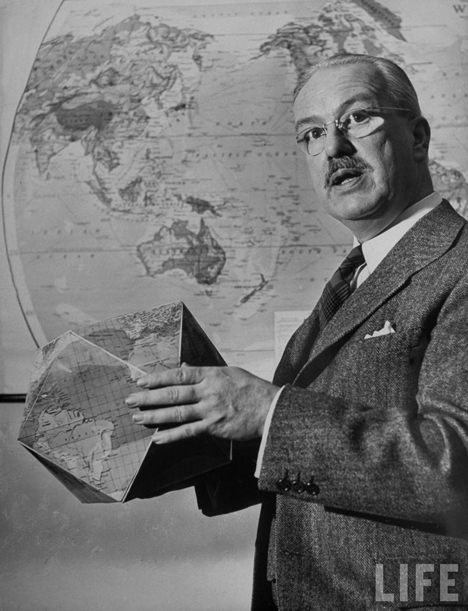 R. Buckminster Fuller with Dymaxion Map as a globe