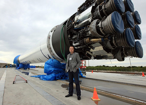 Elon Musk with SpaceX Falcon 9 rocket