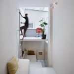 Tiny Madrid apartment by MYCC with rooms connected by a ladder