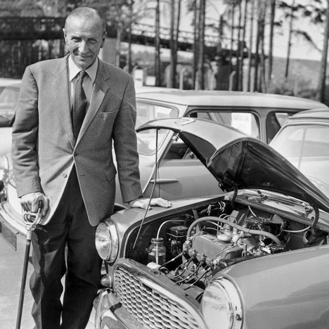 MINI designer Alec Issigonis standing next to his creation