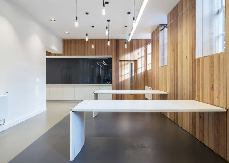 Arts Council England offices with hinged tables by Moxon Architects