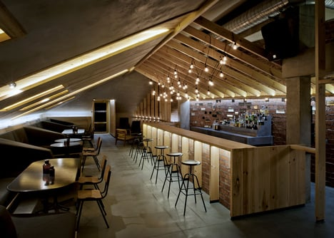 Attic Bar in a Belarus house with low ceilings and exposed brickwork