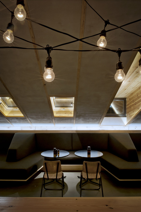 Bar in an attic space in Minsk by Inblum Architects