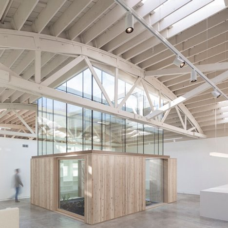 Bowstring Truss House turns a warehouse with a spectacular roof into a home