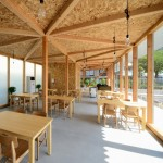 Cafeteria with exposed timber framework by Niji Architects