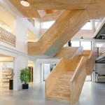 De Burgemeester office with an angular wooden staircase by Studioninedots
