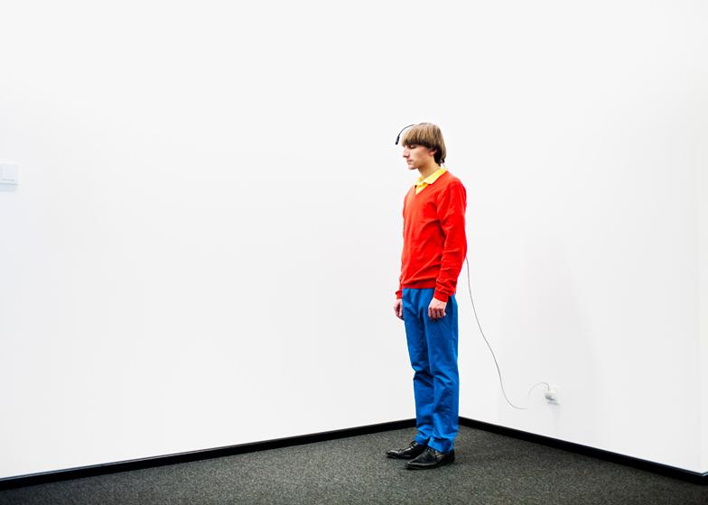 Neil Harbisson charging himself up with electricity via a plug socket.