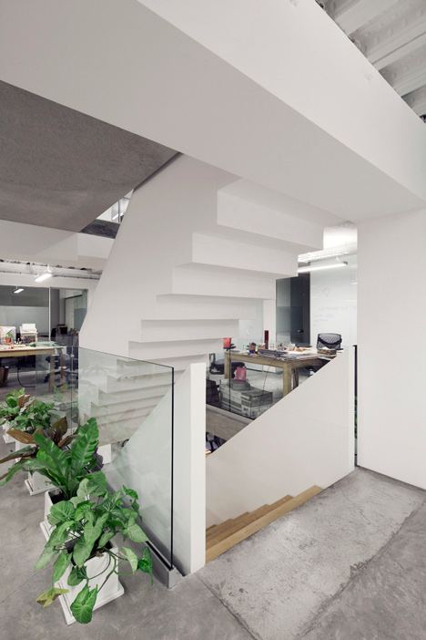 Staircase with upside-down sections at an office in Mexico by Goko