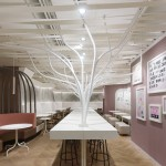 Ippolito Fleitz Group installs metal trees in natural foods restaurant