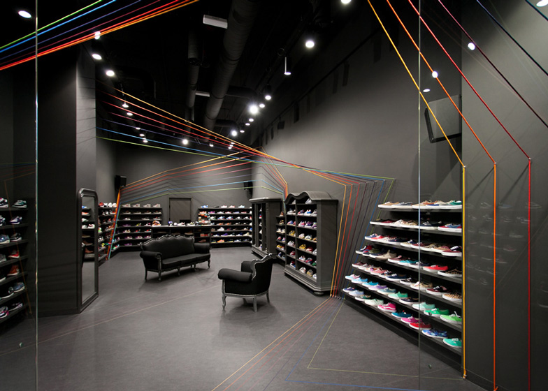Run Colors trainers store by Modelina Architekci