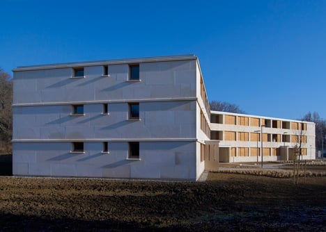 Social housing with solid stone walls by Perraudin Architecture