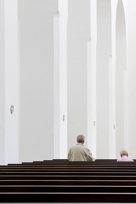 John Pawson's minimal St Moritz Church photographed during a choir rehearsal