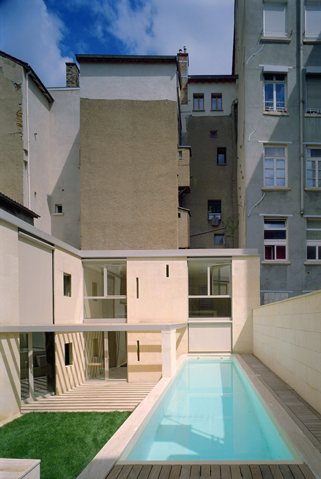 Stone house in Lyon's silk-weaving district by Perraudin Architecture