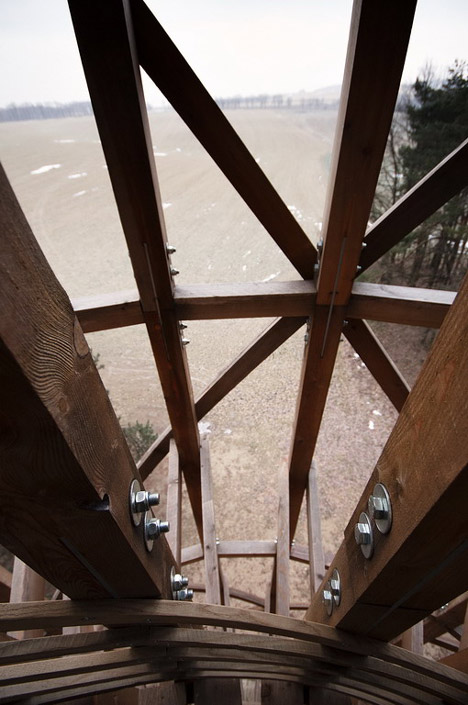 Timber observation tower shaped like a cucumber by Mjölk Architekti